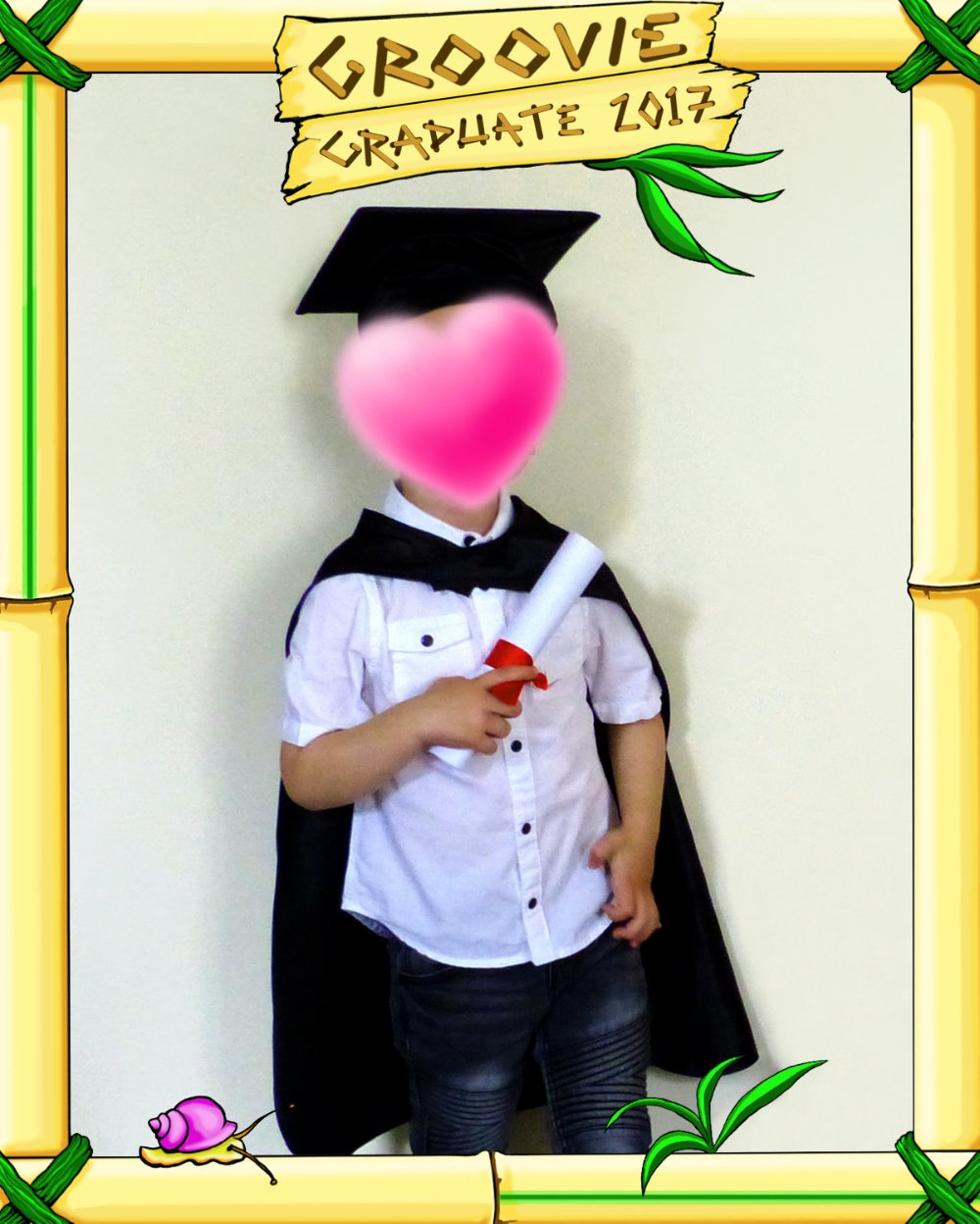 Toddler graduation photo (face hidden) in a digital art bamboo frame to match the childcare setting.