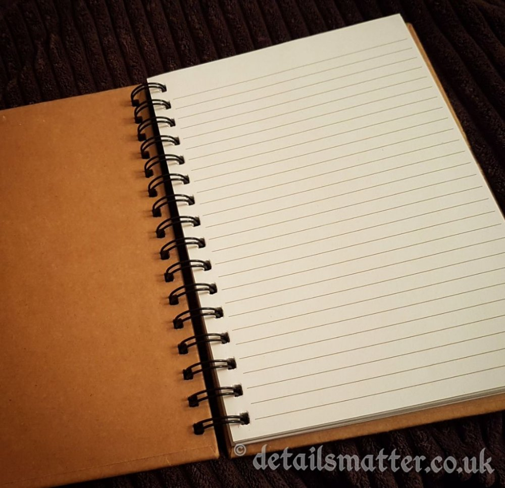 Spiral bound with lined paper pages and kraft covered inner cover